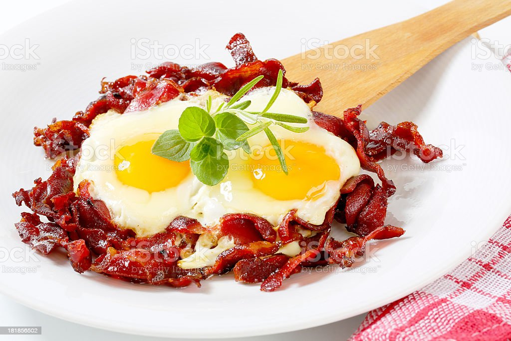 fried eggs with bacon royalty-free stock photo
