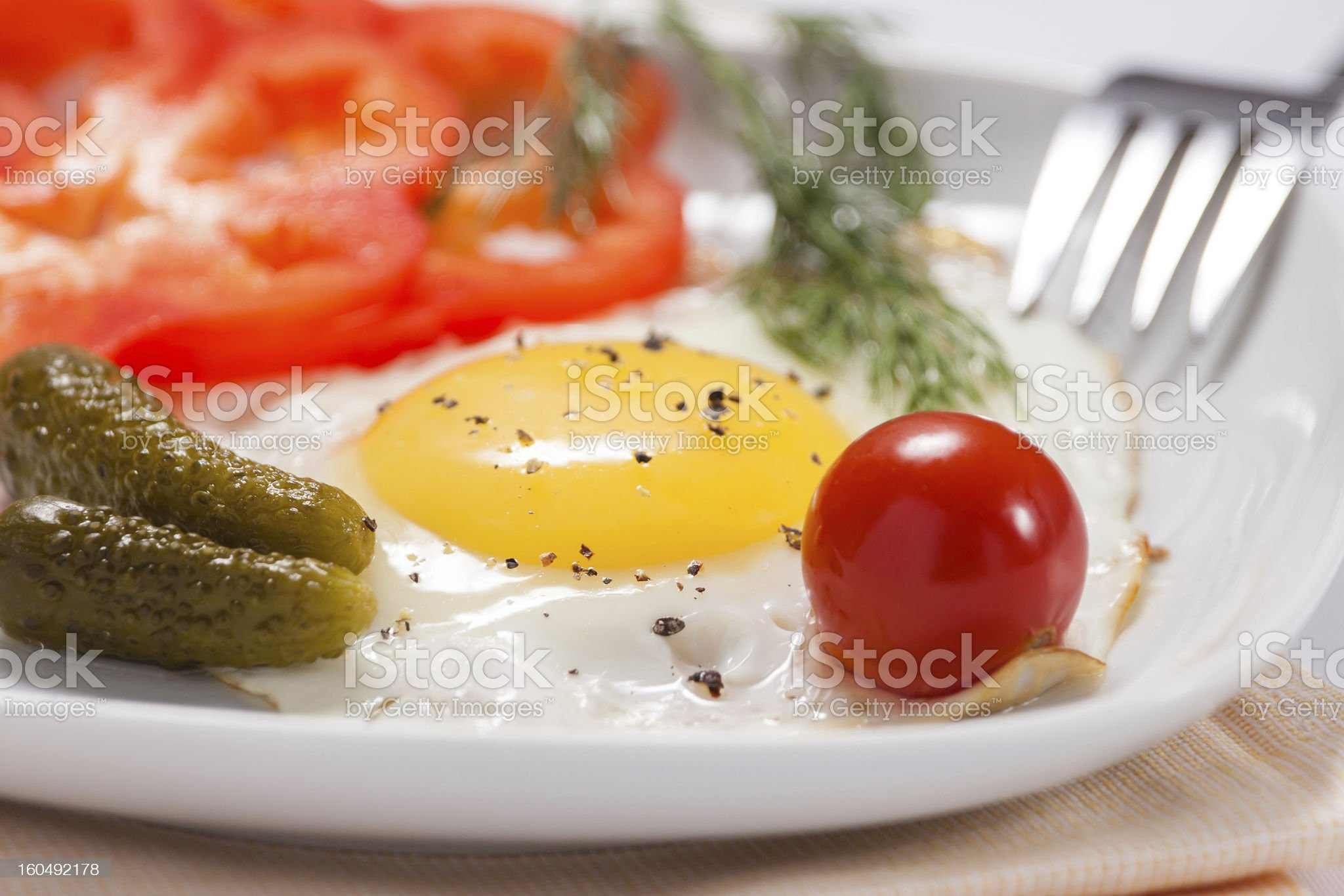 Fried eggs with salty vegetables and greens royalty-free stock photo