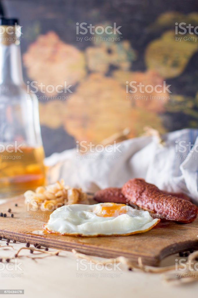 fried eggs with sausages and fried cabbage stock photo
