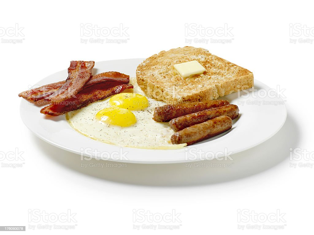 Fried Eggs with Toast, Breakfast Sausage and Strips of Bacon stock photo