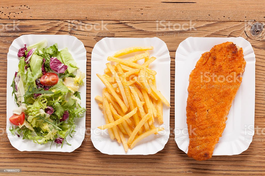 Fried fish and chips on a paper tray stock photo