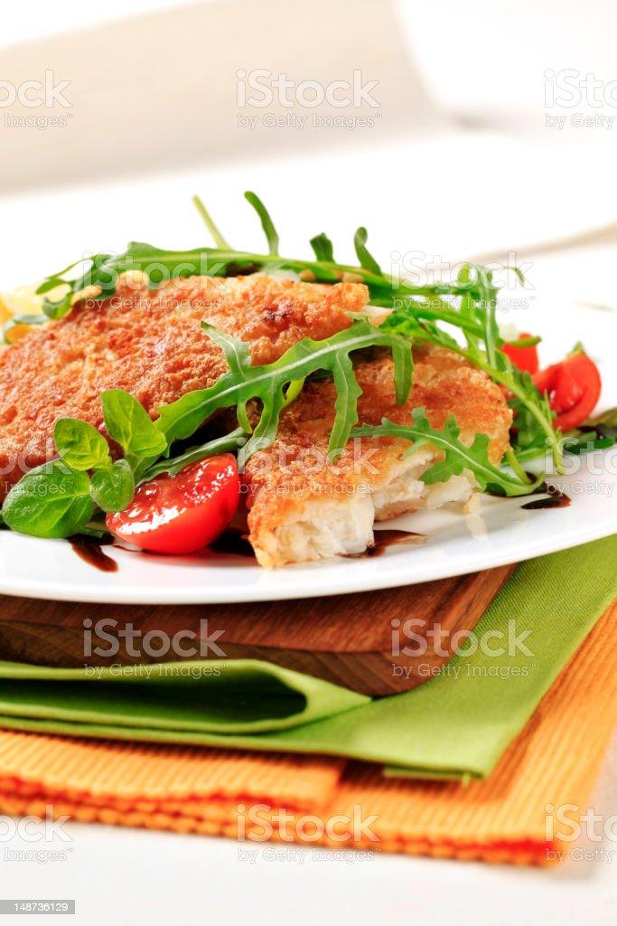 Fried fish and fresh salad royalty-free stock photo