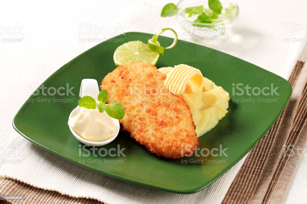 Fried fish and mashed potato stock photo