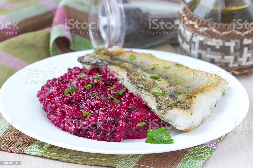 Fried fish fillet of perch with mashed beet and potato royalty-free stock photo