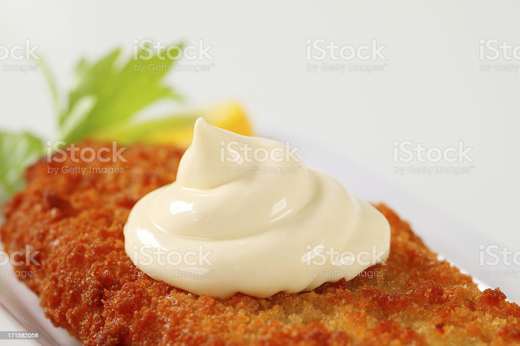 Fried fish fillet with mayonnaise stock photo