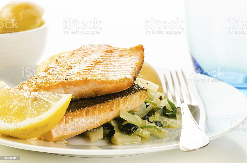 Fried fish fillets with vegetable garnish stock photo