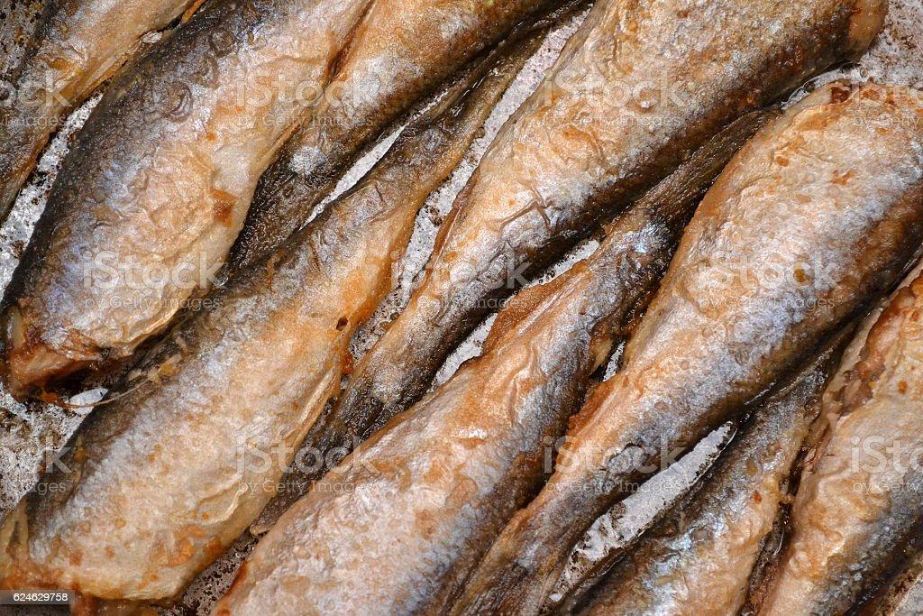 Fried fish herring, Fried fish in a frying pan. stock photo