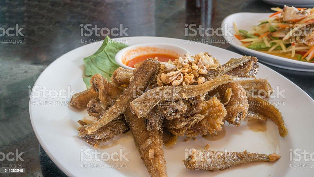 Fried fish on dish stock photo