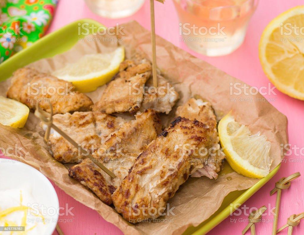 Fried fish Pescado frito with lemon mayonnaise stock photo