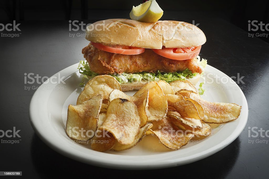 Fried Fish Sandwich and Chips stock photo
