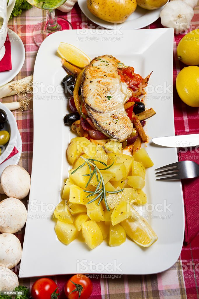 Fried Fish Steak and Side Dish stock photo