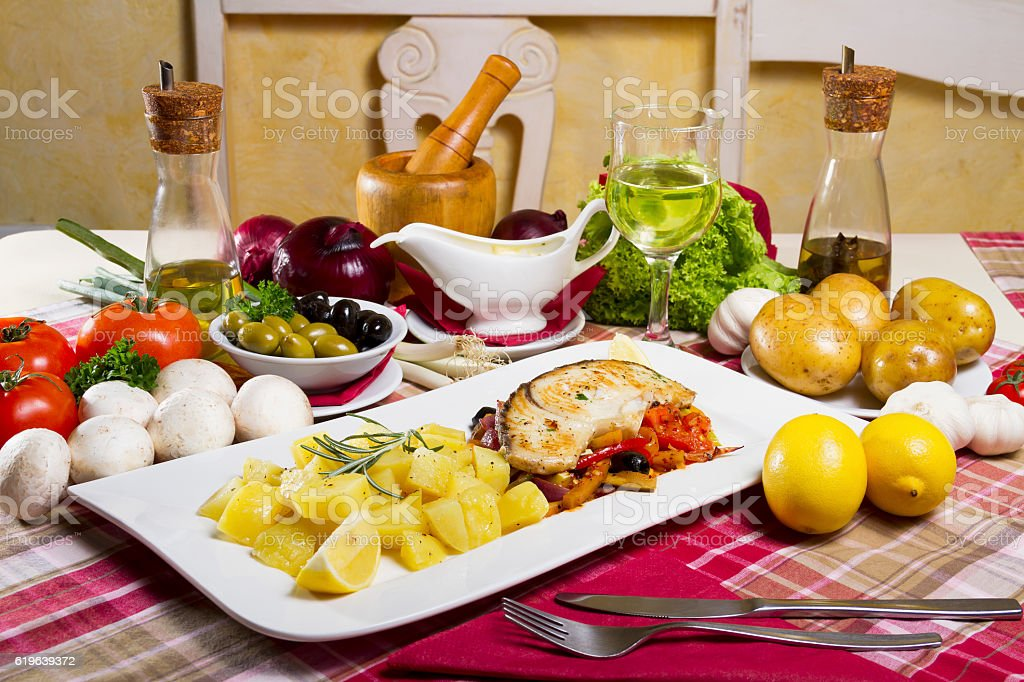Fried Fish Steak Side Dish and Fresh Vegetables stock photo