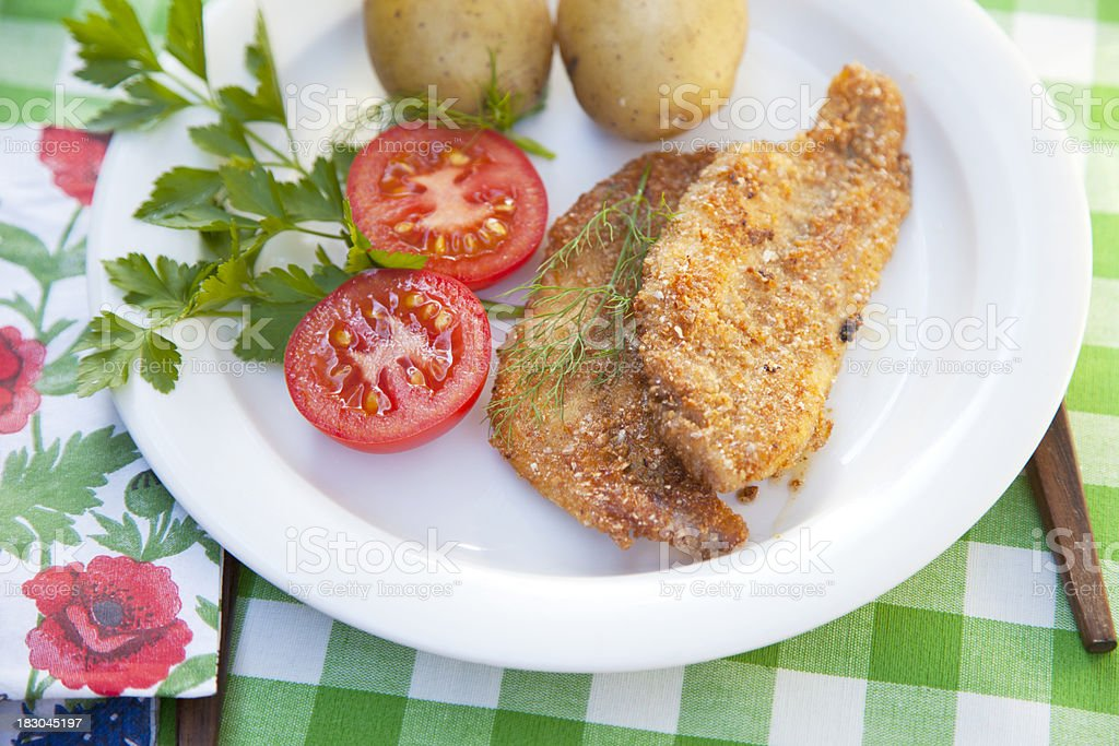 'Fried fish with boiled potatoes, beer and aquavit' stock photo