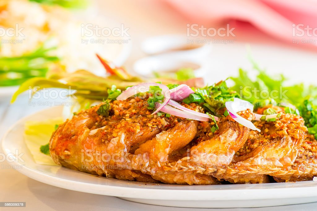 Fried Fish with Chili Sauce stock photo
