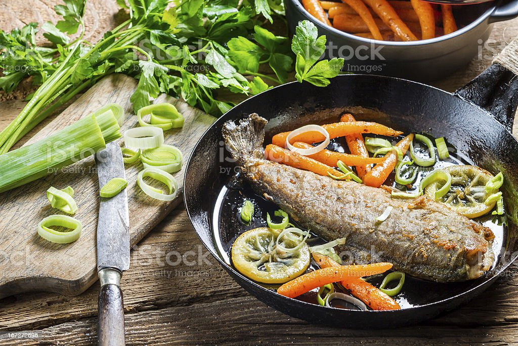 Fried fish with leek and carrot royalty-free stock photo