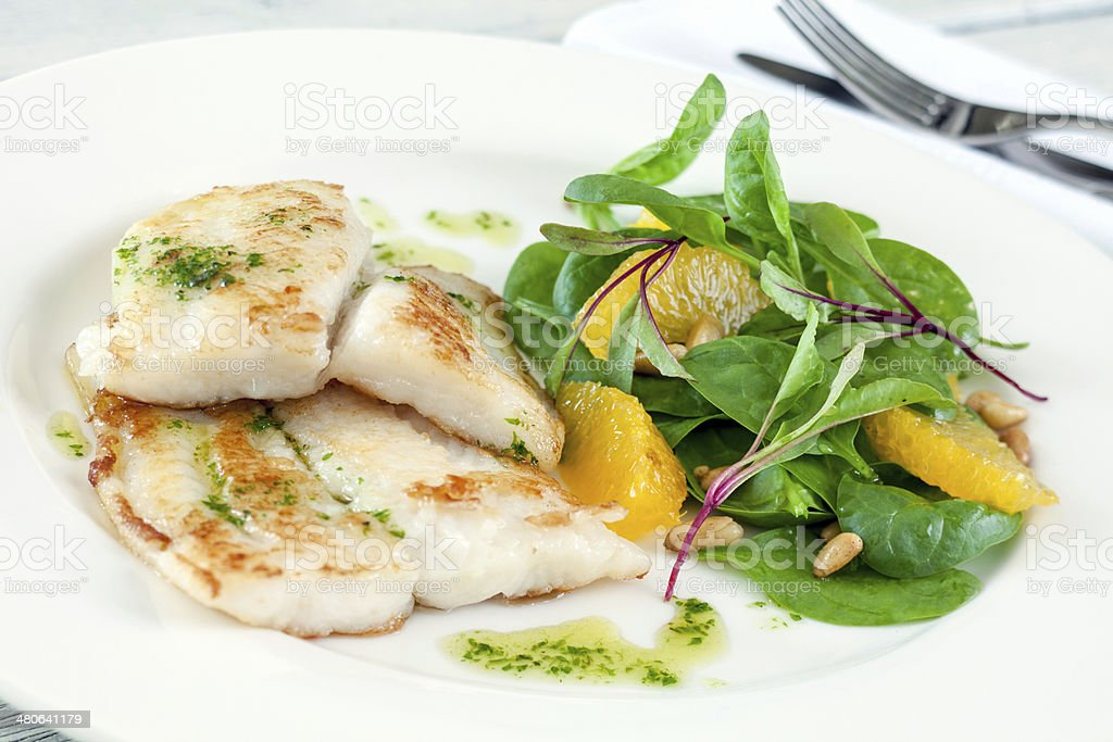 Fried fish with salad royalty-free stock photo