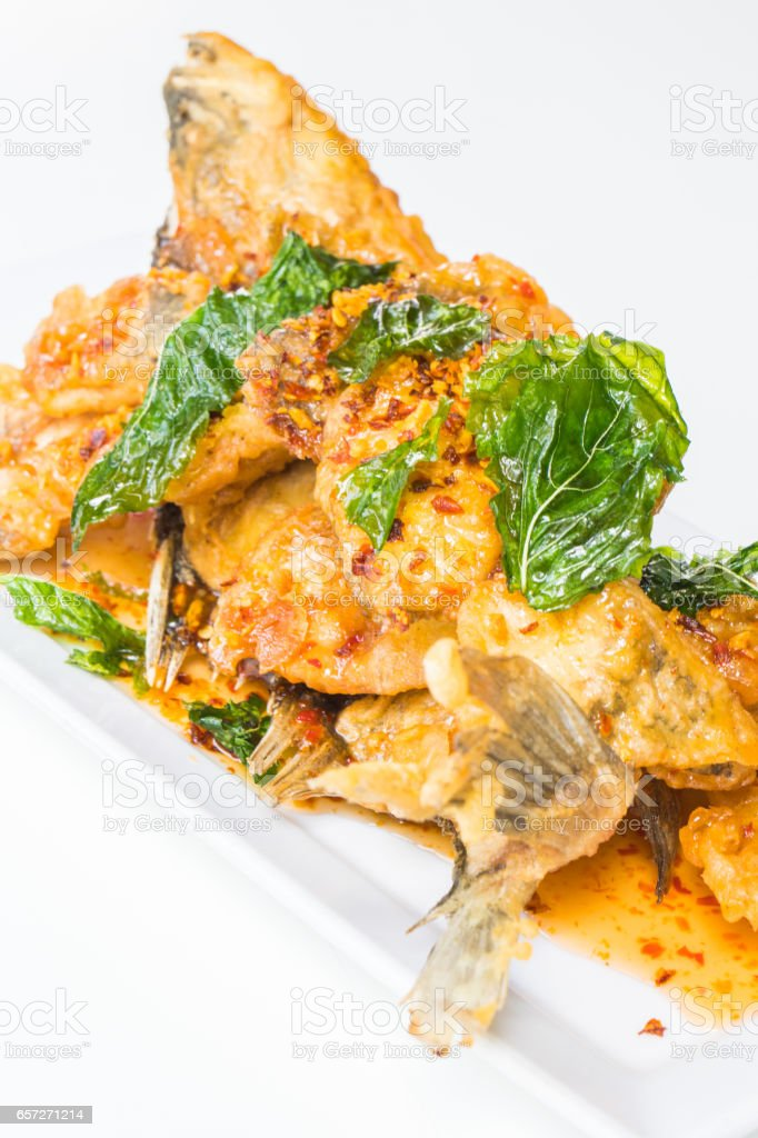 Fried fish with spicy sauce stock photo