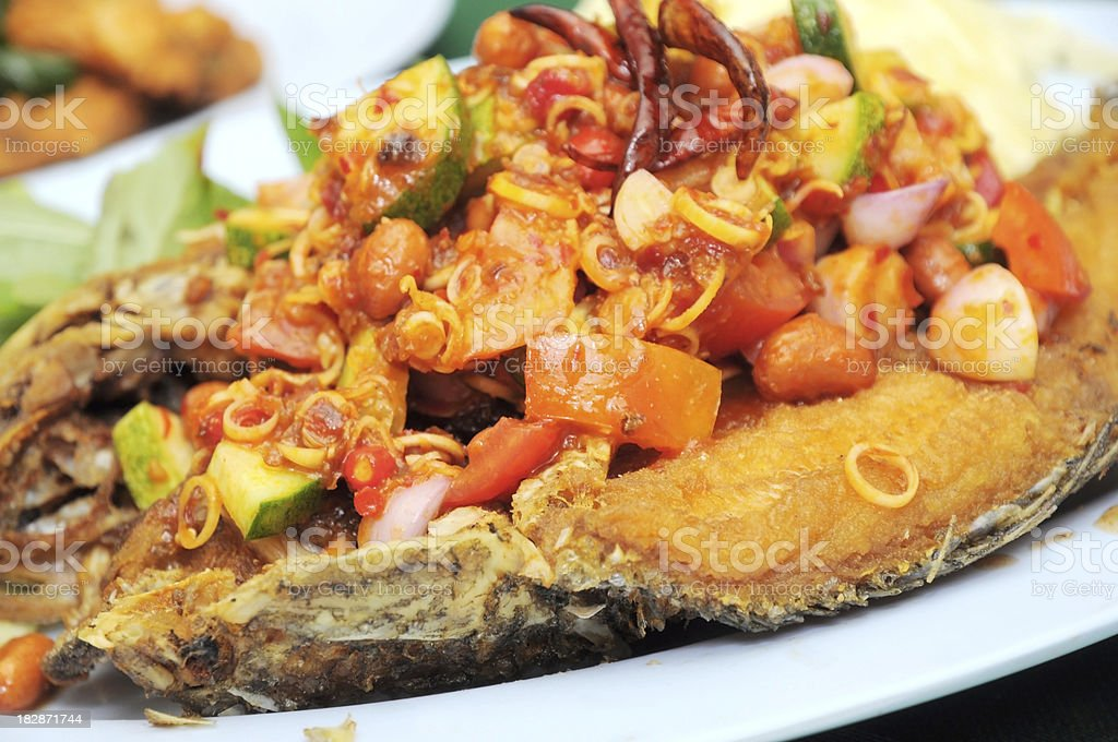 Fried fish with tomato and cucumber stock photo