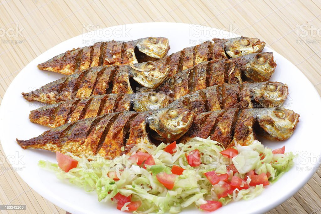 Fried fish with vegetables royalty-free stock photo