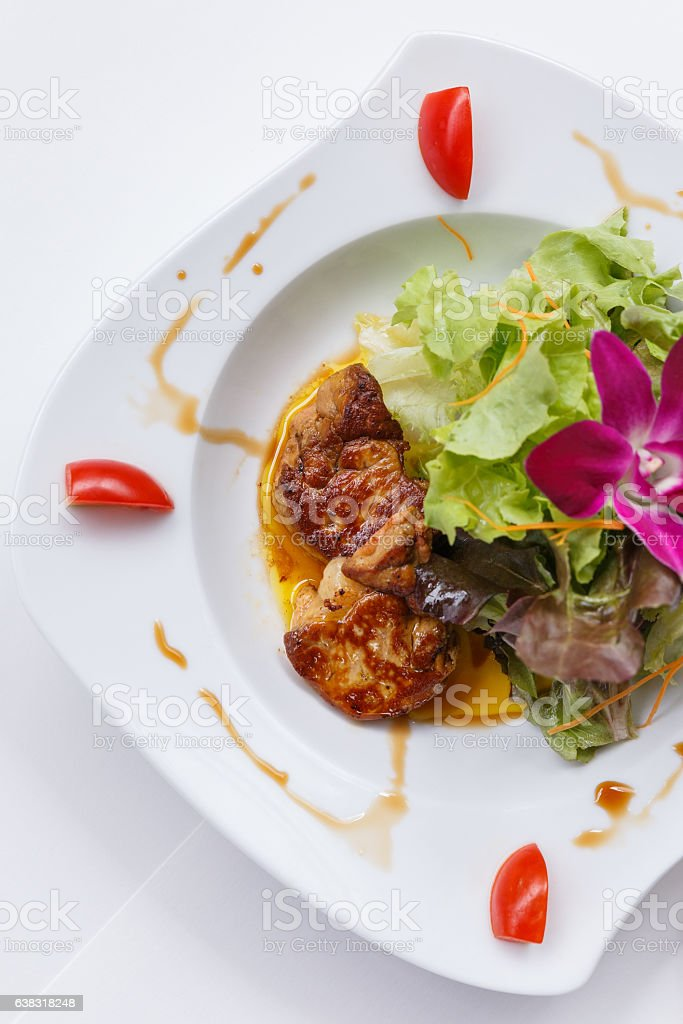 Fried Foir Gras Served with Salad and Sauce. stock photo