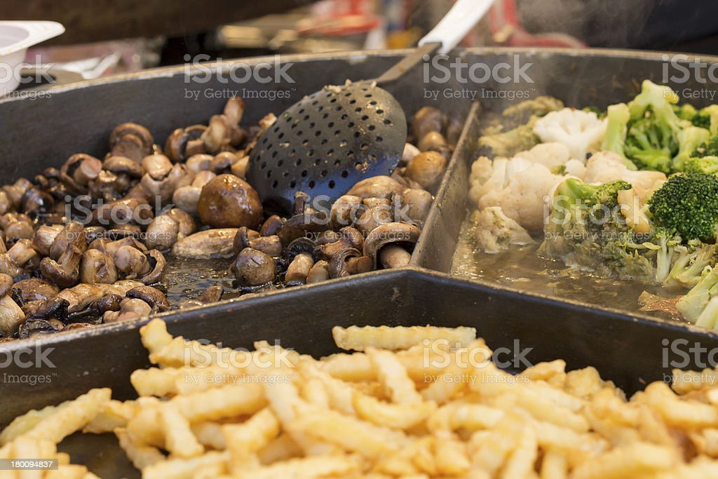 Fried Foods at Jarmark St. Dominic in Gdansk royalty-free stock photo