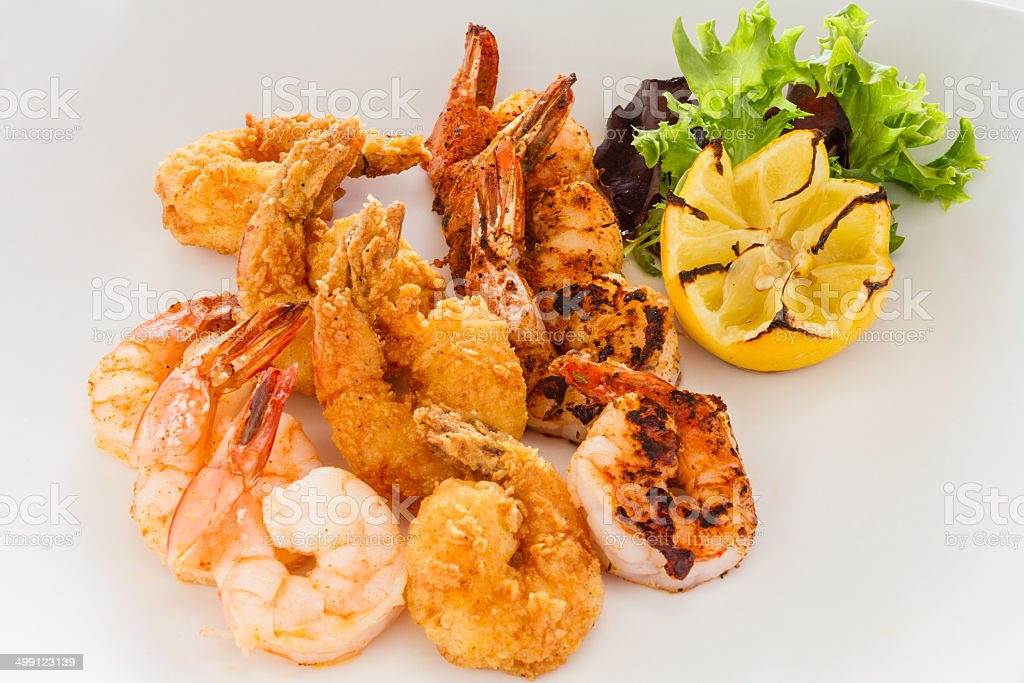 Fried, grilled, and blackened shrimp. stock photo