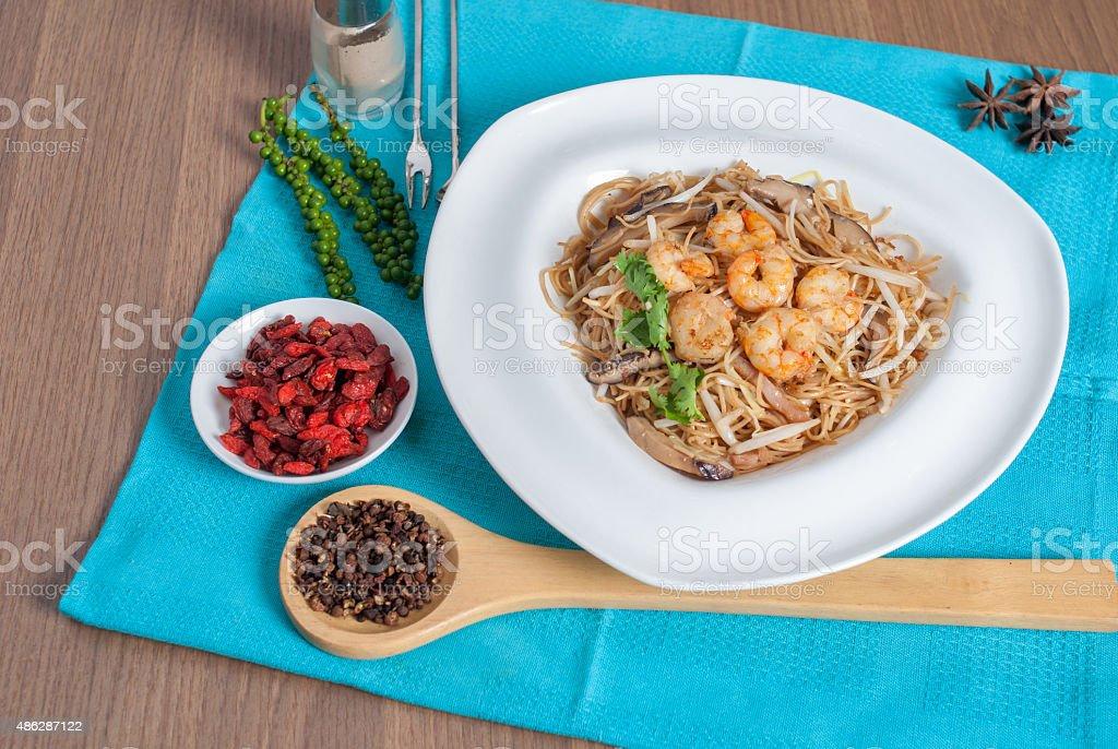 fried Hong Kong noodles topped with shrimp menu stock photo