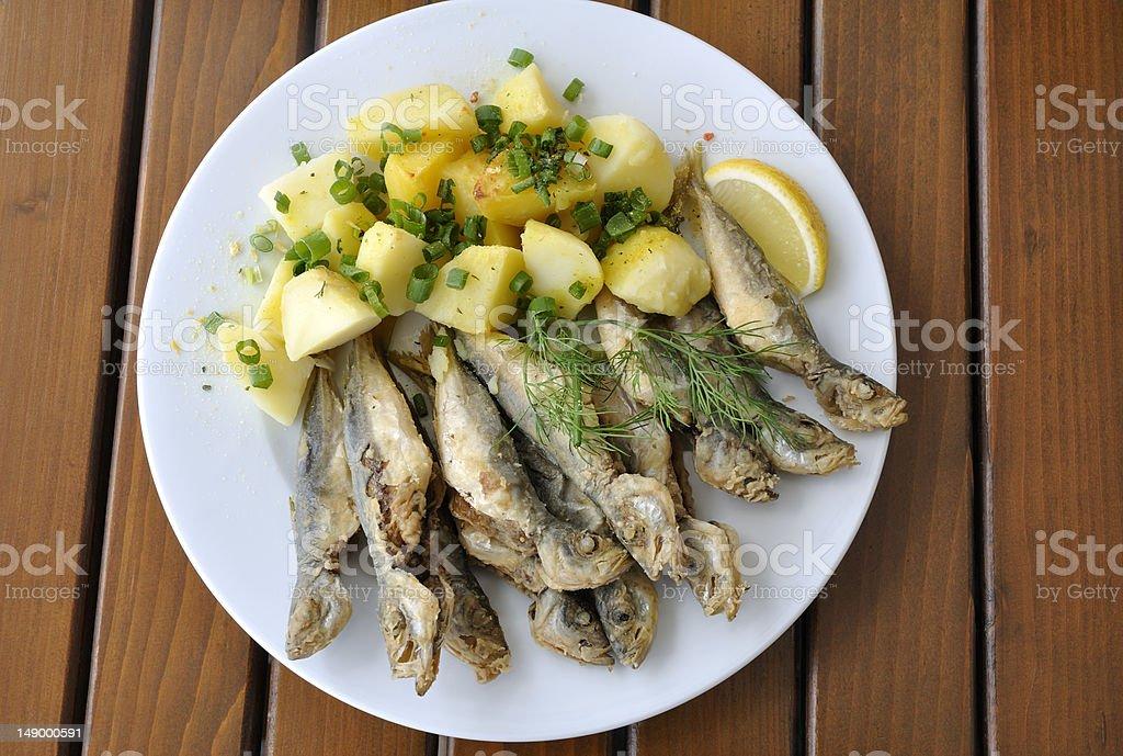 Fried horse mackerel with boiled potatoes stock photo