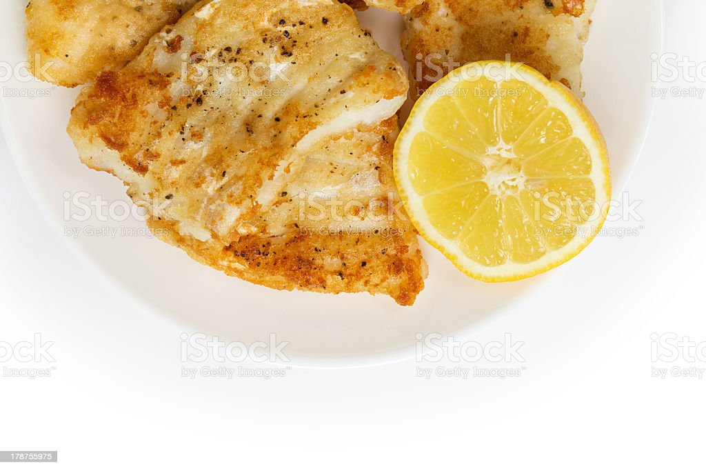 fried in flour codfish on plate royalty-free stock photo