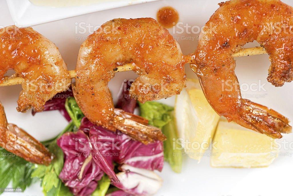 Fried kebab of shrimps stock photo
