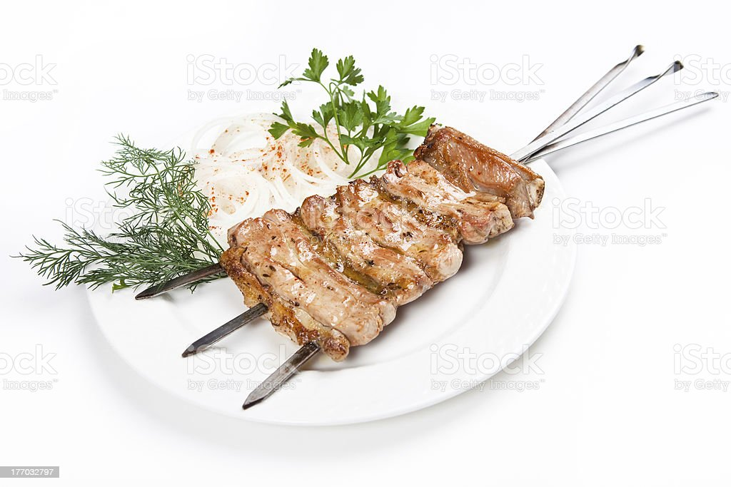 fried kebab with onion on plate royalty-free stock photo