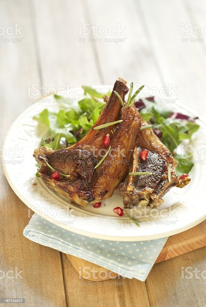 Fried lamb with pomegranate and salad royalty-free stock photo