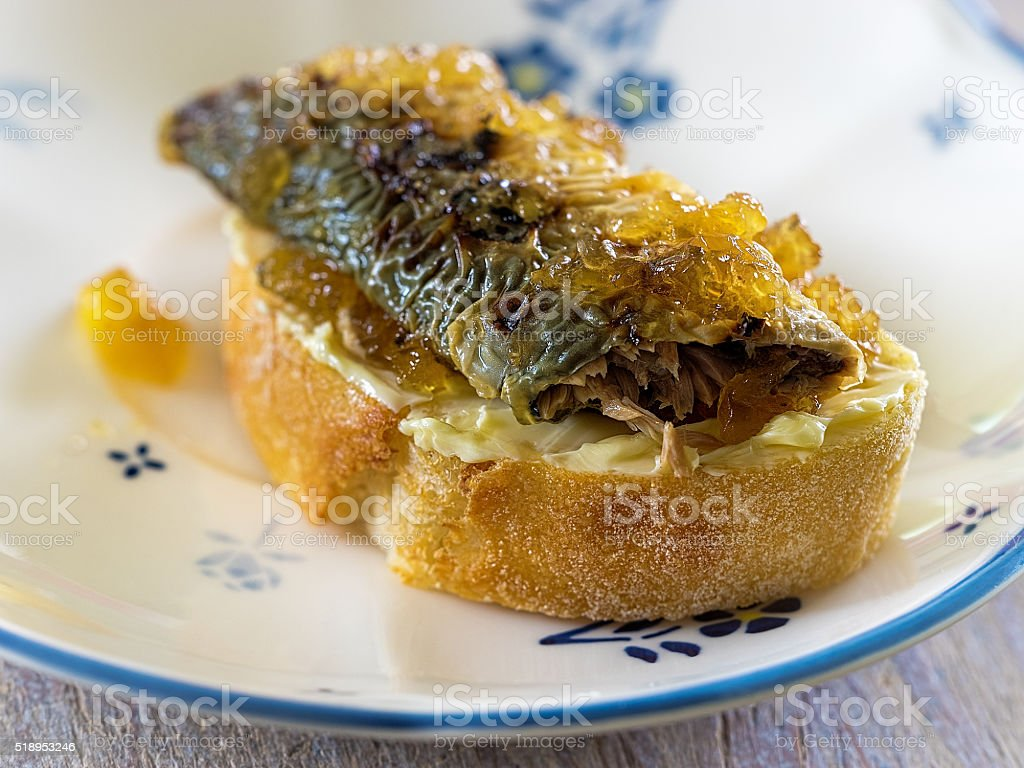Fried lamprey canapes on a baguette royalty-free stock photo
