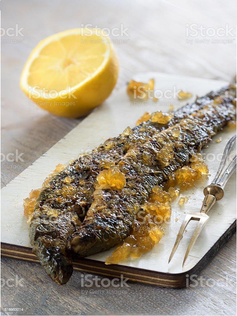 Fried lamprey with lemon royalty-free stock photo