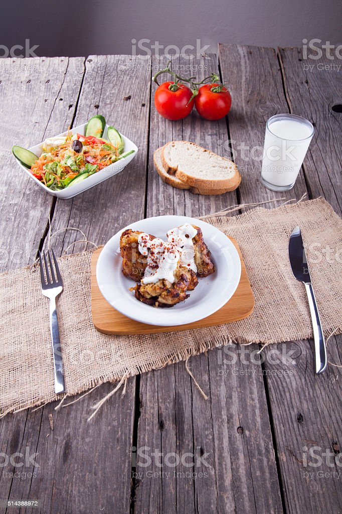 Fried Large Broccoli in the batter serving with yogurt sauce stock photo