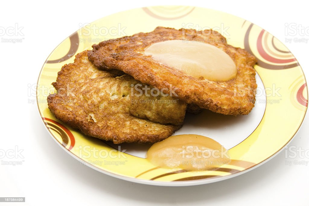 Fried mashed potatoes with apple porridge on plate stock photo
