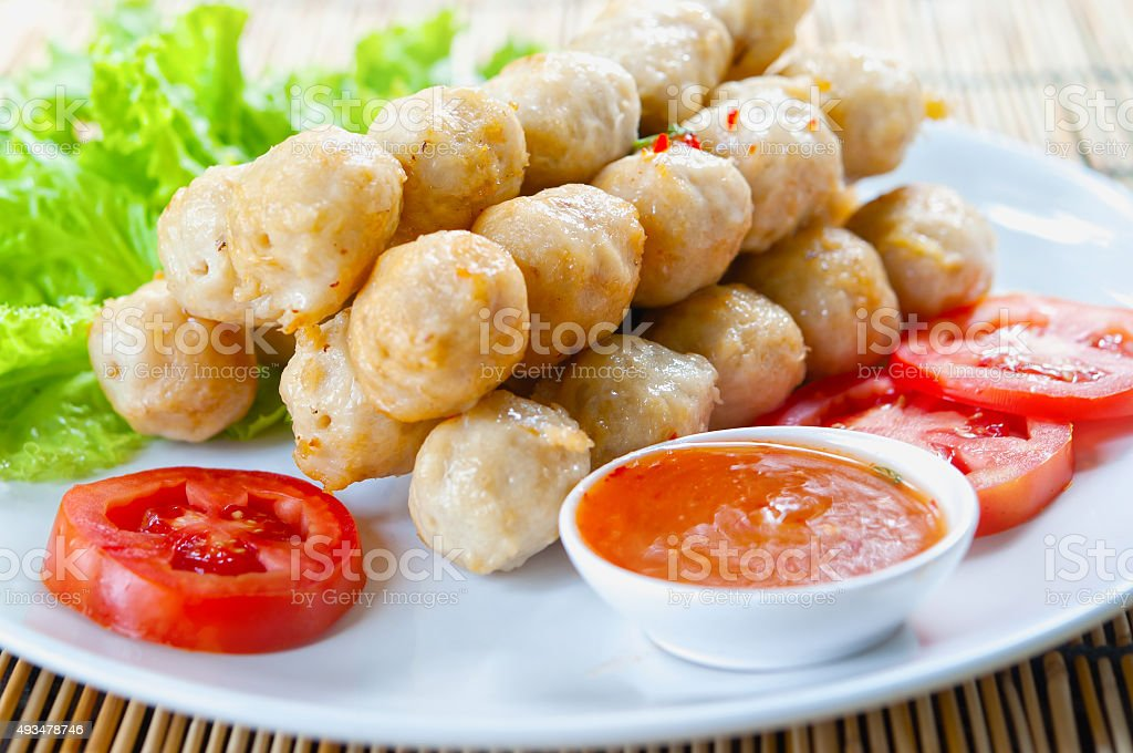 fried meat ball and vegetable on white dish stock photo