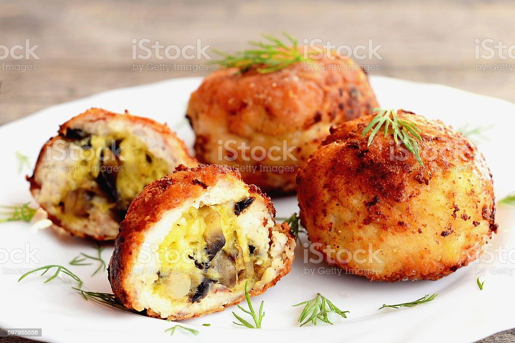 Fried meat balls stuffed with cheese andmushrooms stock photo