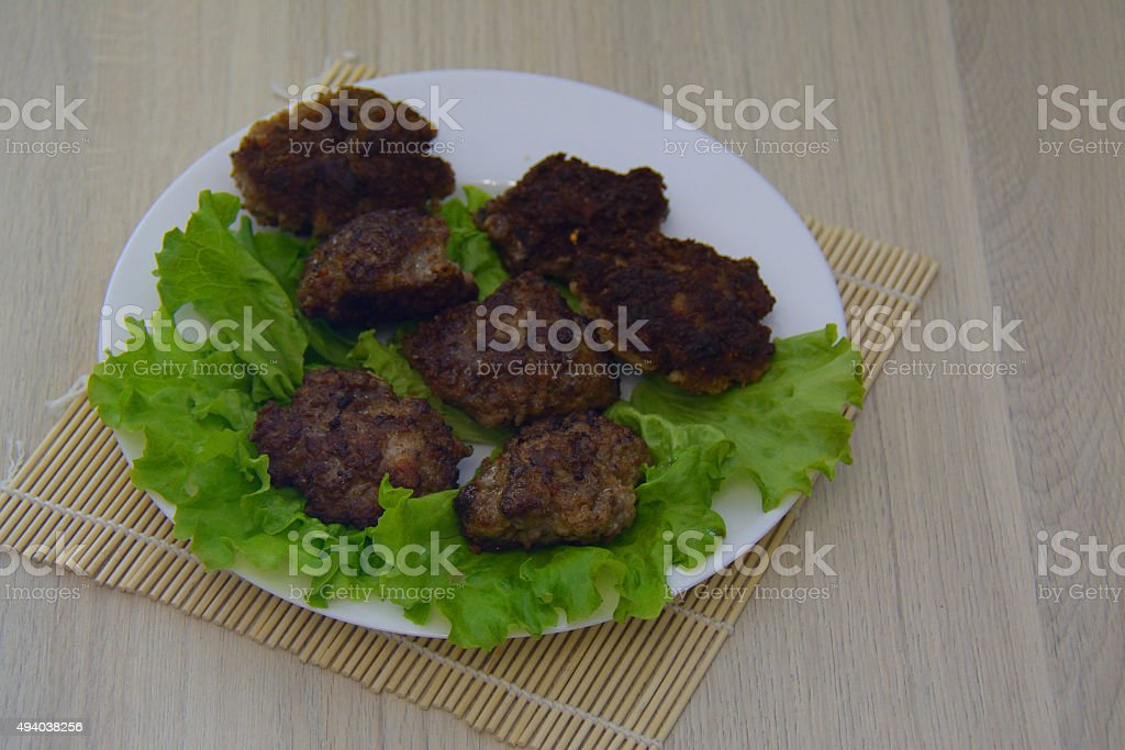Fried meat cutlets, with salad leaves stock photo