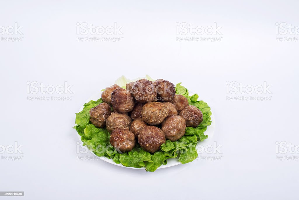 fried meatball and Romaine Lettuce stock photo