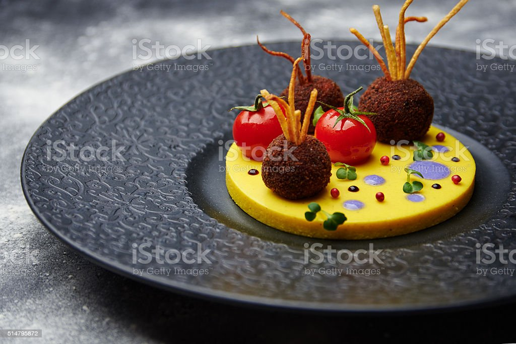 Fried meatballs with tomato on a potatoes stock photo