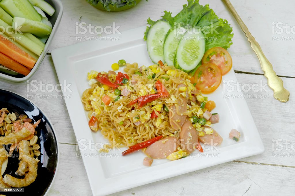 Fried medium noodle with vegetable. stock photo