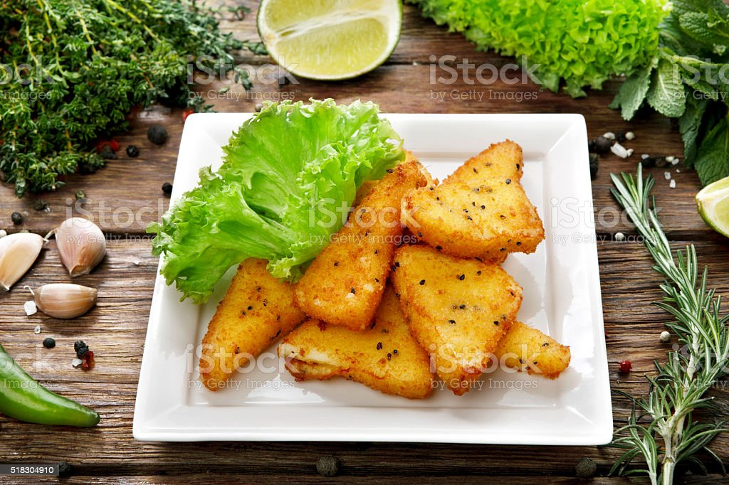 Fried Mozzarella with lettuce at wood stock photo