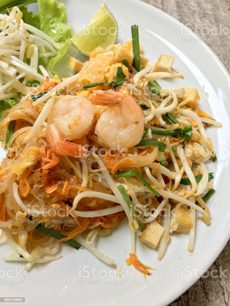 Fried noodle Thai style with prawns, Stir fry noodles. stock photo