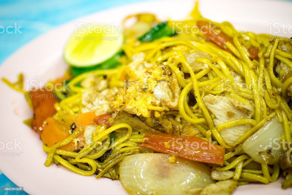 fried noodle with egg vegetable and pork stock photo