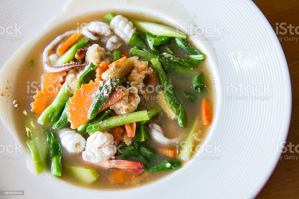 Fried noodle with seafood and broccoli stock photo