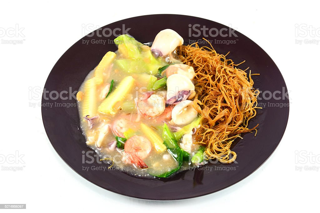 Fried noodle with shrimp ,squid and vegetable stock photo
