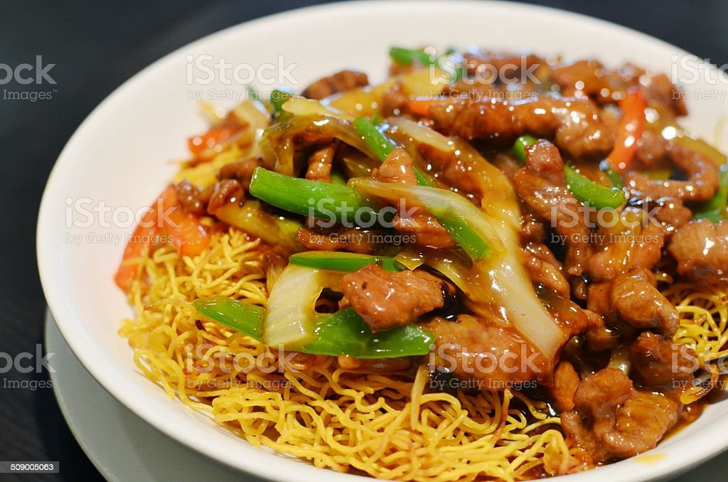 Fried noodles with beef tenderloin strips stock photo
