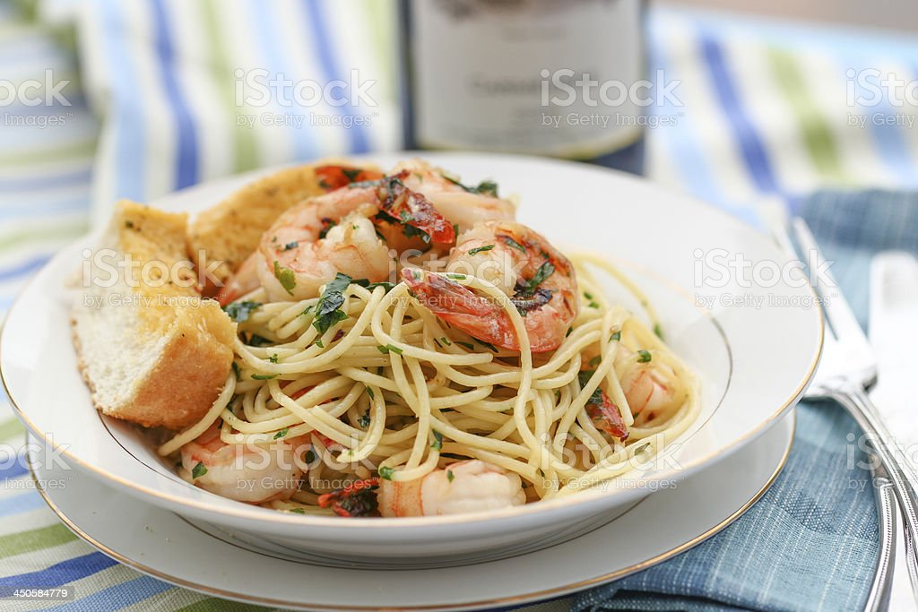 Fried noodles with shrimps and garlic breads stock photo