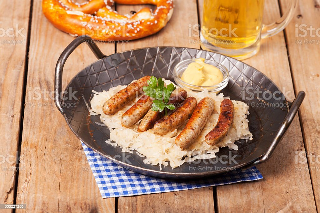 fried nuremberger sausages stock photo